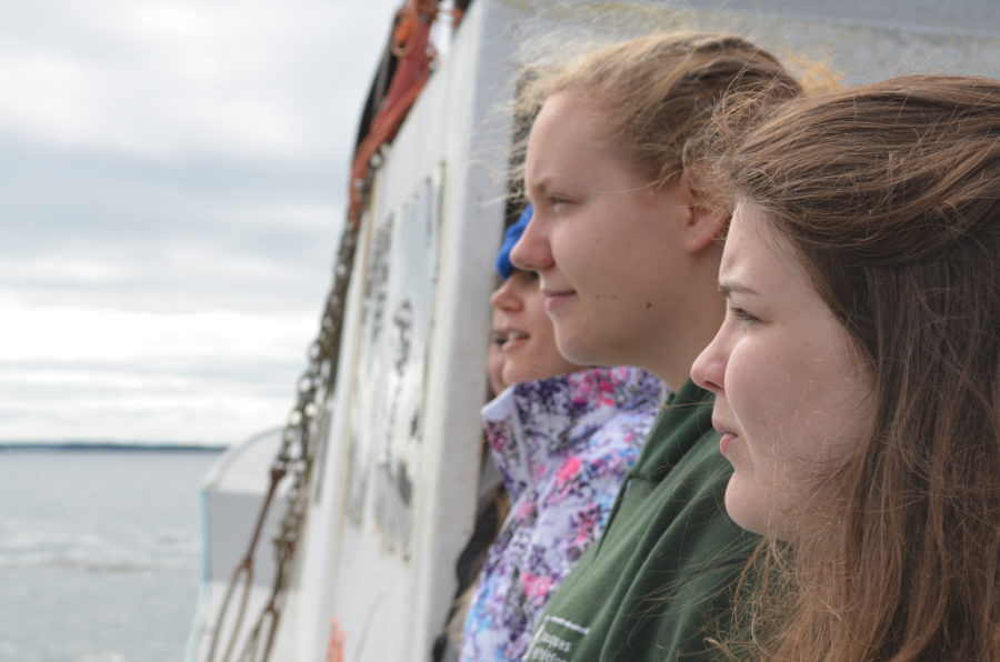 Students enjoy life together, on a boat